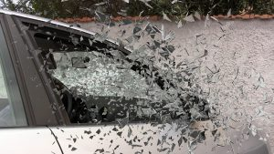 car accident picture of broken glass flying